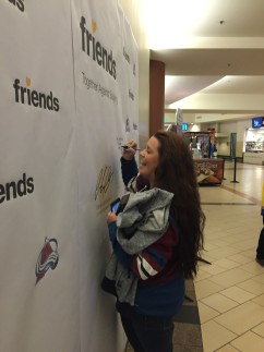 Pepsi Center Pledge Wall Woman signing